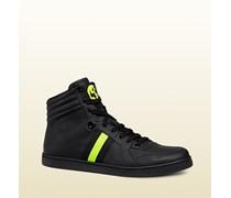 hoch geschnittener Sneaker aus schwarzem Leder mit Neon