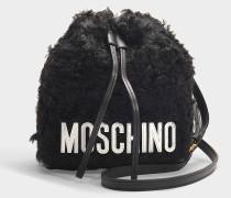 Bucket Bag aus Shearling Fuchsia