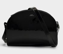 Tasche Demi-Lune aus schwarzem Lackleder