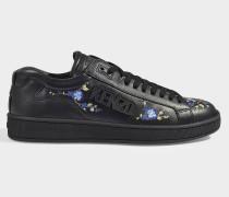 Bestickte Sneaker Tennix aus schwarzem Leder
