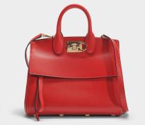 Kleine Handtasche Studio aus rotem Kalbsleder
