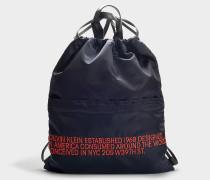 Rucksack mit Schnürbändern aus marineblauem und rotem Kalbsleder