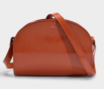 Tasche Demi-Lune aus orangem Lackleder