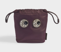 Drawstring Crystal Eyes Clutch en bordeaux farbenem Nylon