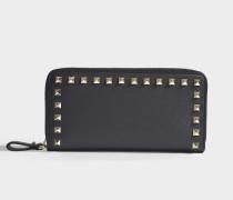 Portemonnaie Continental mit Reißverschluss Rockstud aus schwarzem Kalbsleder