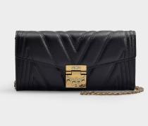 Portemonnaie mit Taschenklappe Patricia aus bedrucktem Stoff aus schwarzem Kalbsleder