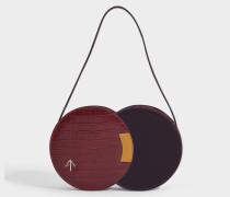 Handtasche Twist aus bordeauxrotem und senfgelbem, kroko-geprägtem, natürlich gegerbtem Lackleder