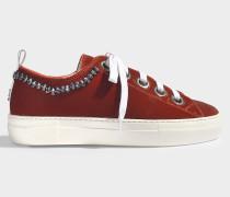 Sneaker aus orangem Velours und Kristallen