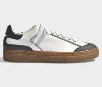 Sneaker Bicolores aus glattem, weißem Kalbslederund Kristallen