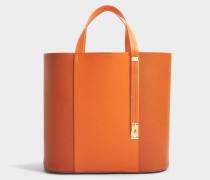 The Exchange E-W Tasche aus Burnt orangefarbenem und Clementine Kuhleder