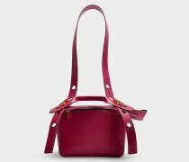 Kleine Handtasche The Bolt aus rosa Kalbsleder