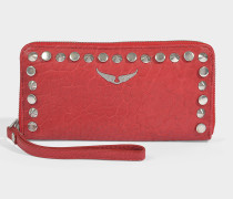 Portemonnaie mit Reißverschluss Compagnon Outli aus rotem Kalbsleder mit Nieten