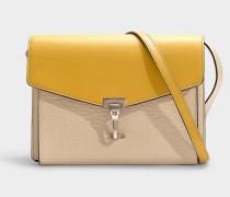Kleine Handtasche Macken aus kalkfarbenem und gelben Kalbsleder