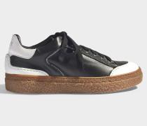 Sneaker Bicolores aus schwarzem, glattem Kalbsleder und Kristallen