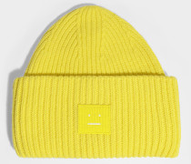 Mütze Pansy N Face aus gelber Wolle