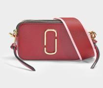 Tasche Snapshot aus Leder mit roter Polyurethanbeschichtung