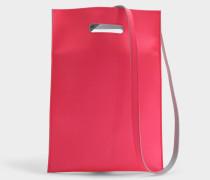 Hand Carry Plastic Bag aus neonrosanem Synthetik Leder