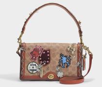 Turnlock Crossbody Tasche aus Rust Logo Canvas