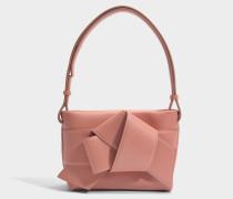 Musubi Handtasche aus rosanemnem Kalbsleders- und Lammleder