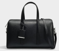 Handtasche Taylor Duffle aus genarbtem Kalbsleder in Schwarz