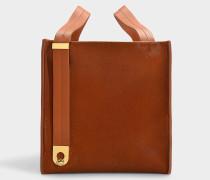Handtasche Exchange Cube aus braunem Kalbsleder