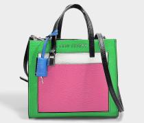 Handtasche The Mini Grind Colorblocked aus jadegrünem und buntem Kalbsleder
