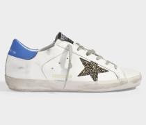 Sneaker Superstar aus weißem und blauem Leder und glitzernden Sternen