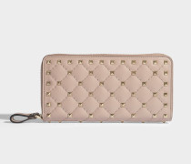 Rockstud Spike Zip Around Continental Geldbörse aus Powder Nuancen Nappaleder
