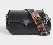 Guitar Rockstud Rolling Shoulder Bag aus schwarzem und mehrfarbigem Craqued Lammleder