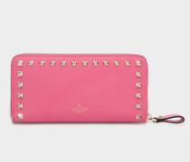 Rockstud Zip Around Continental Geldbörse aus Shadow rosanem Kalbsleder