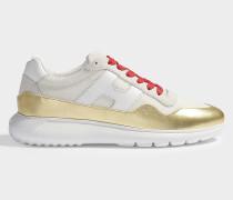 Sneaker Interactive Cube aus goldenem und weißem Leder