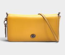 Handtasche Dinky Porté Travers aus leinenfarbigem Kalbsleder