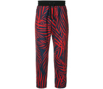 palm print tapered trousers