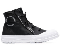 black Chuck Taylor MC18 high top sneakers