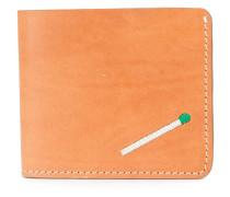 Portemonnaie mit Streichholz