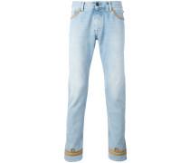 Skinny-Jeans mit goldfarbener Paspelierung
