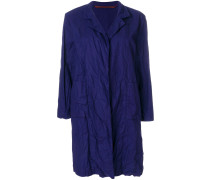 creased trench coat