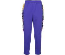 side fringe trousers