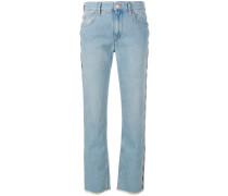 Jeans mit Fransen und Stickerei