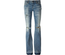 Schlagjeans in Distressed-Optik