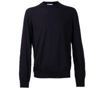 Pullover mit Flicken am Ellenbogen