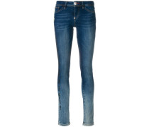 Skinny-Jeans mit Blumen-Patch