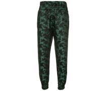 cropped foliage patterned trousers