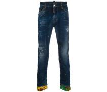 'Skater' Jeans mit Farbklecks-Print