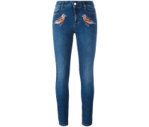Skinny-Jeans mit Vogelstickerei