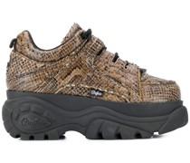 Sneakers mit Schlangeneffekt
