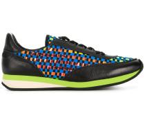 Sneakers mit gewebten Einsätzen