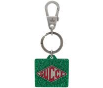 Glitzernder Schlüsselanhänger mit Logo