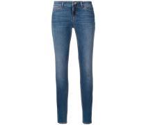 Skinny-Jeans mit Blumenknopf