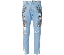 distressed and embellished cropped jeans